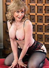 Cougar Nina Hartley fucking in the living room with her tits