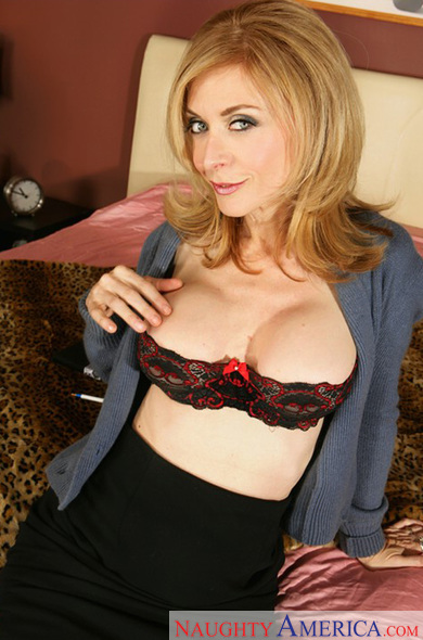 Nina Hartley fucking in the bedroom with her tits